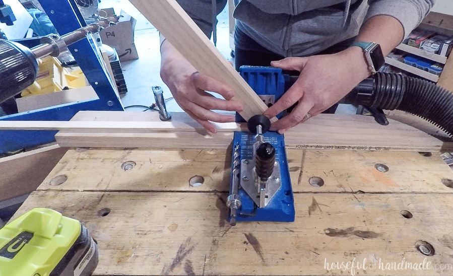 Photo showing how to prop up the edge of an angled board when adding a pocket hole to it.