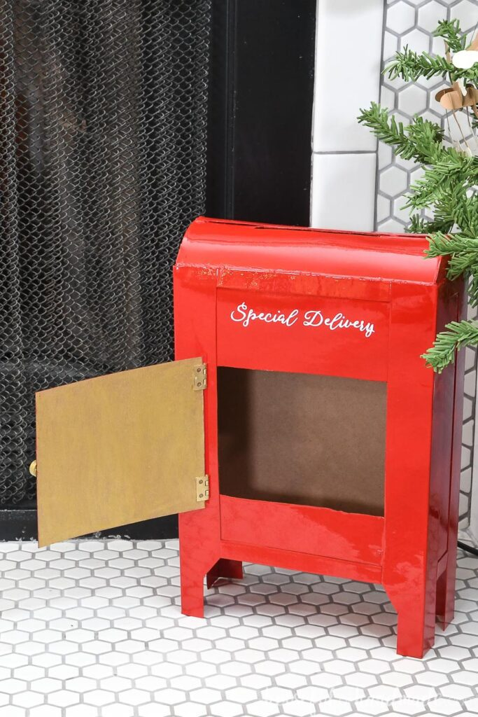 Santa's mailbox DIY with the front door open showing how to remove the letters.