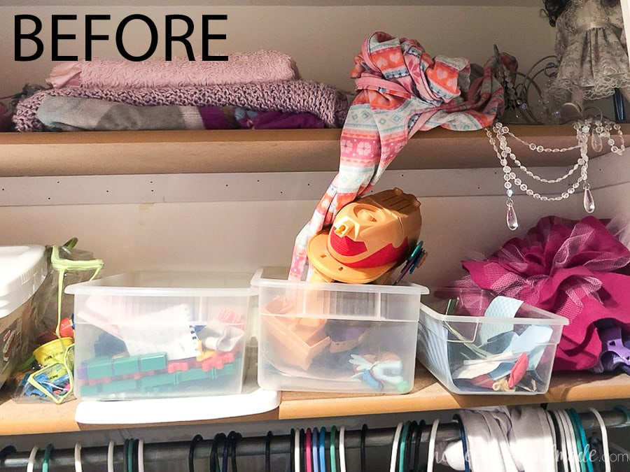 Close up of the current shelves in the closet before the $100 kids closet makeover.