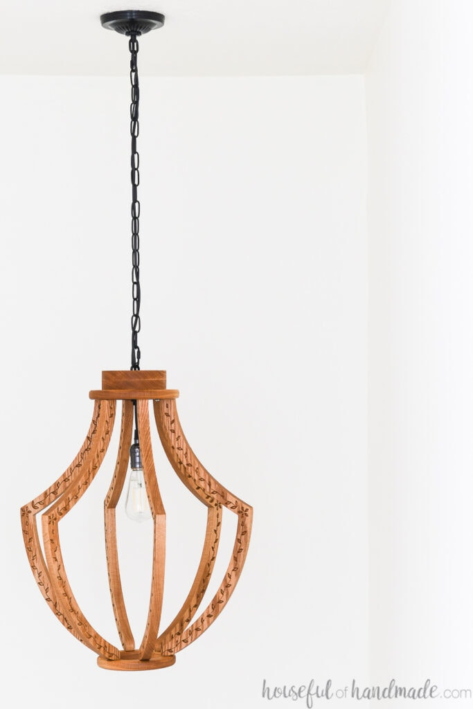 DIY chandelier made from wood hanging from the ceiling.