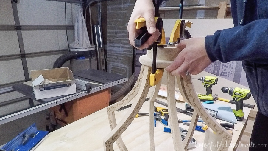 Glueing the top piece to the top of the DIY chandelier.