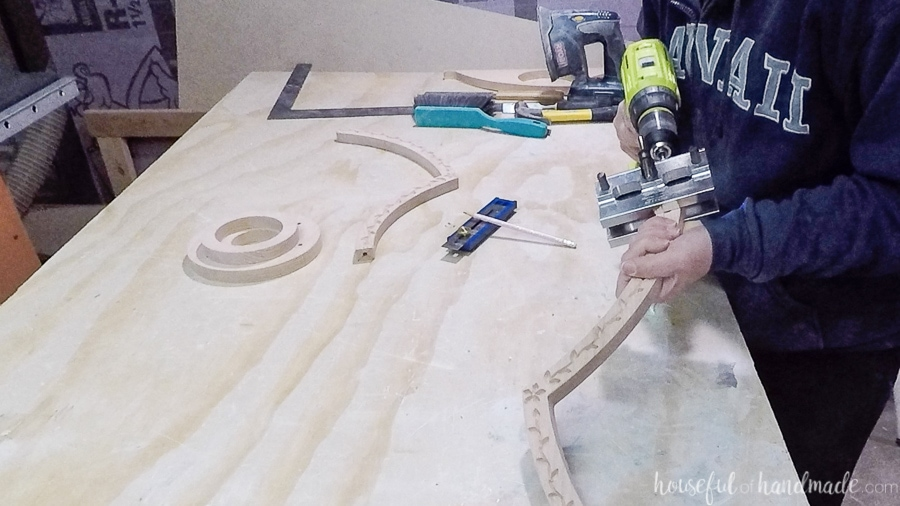 Drilling holes for dowels in the side pieces with a doweling jig.