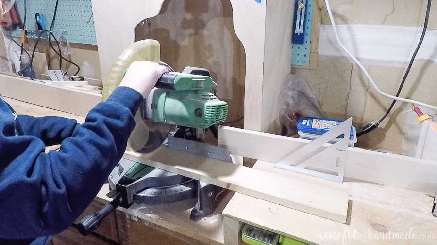 Cutting 1x4 boards at the miter saw.