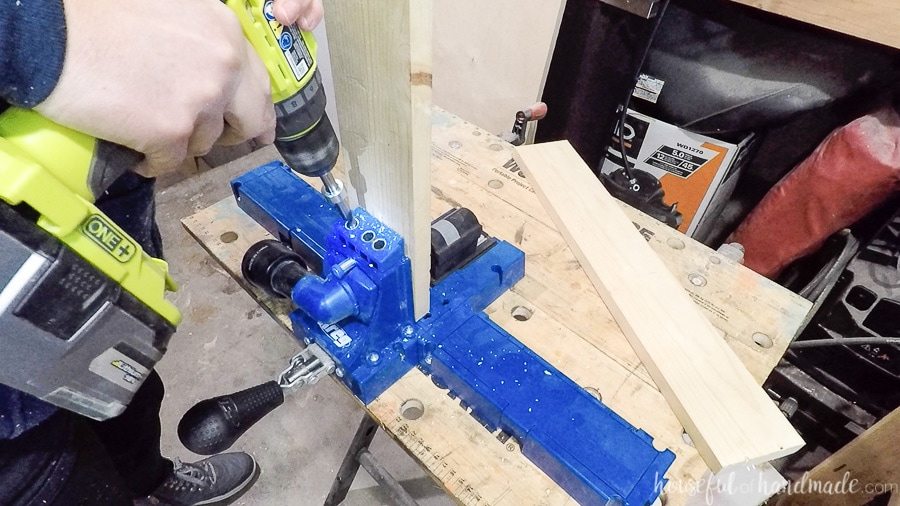 Drilling pocket holes with the Kreg K5 pocket hole jig.