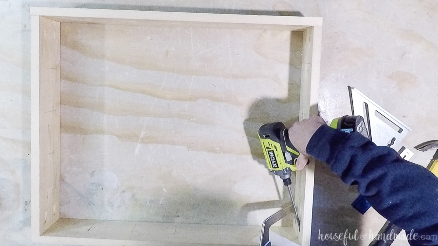 Finishing off the frame of the shoe organizer with pocket hole joinery.