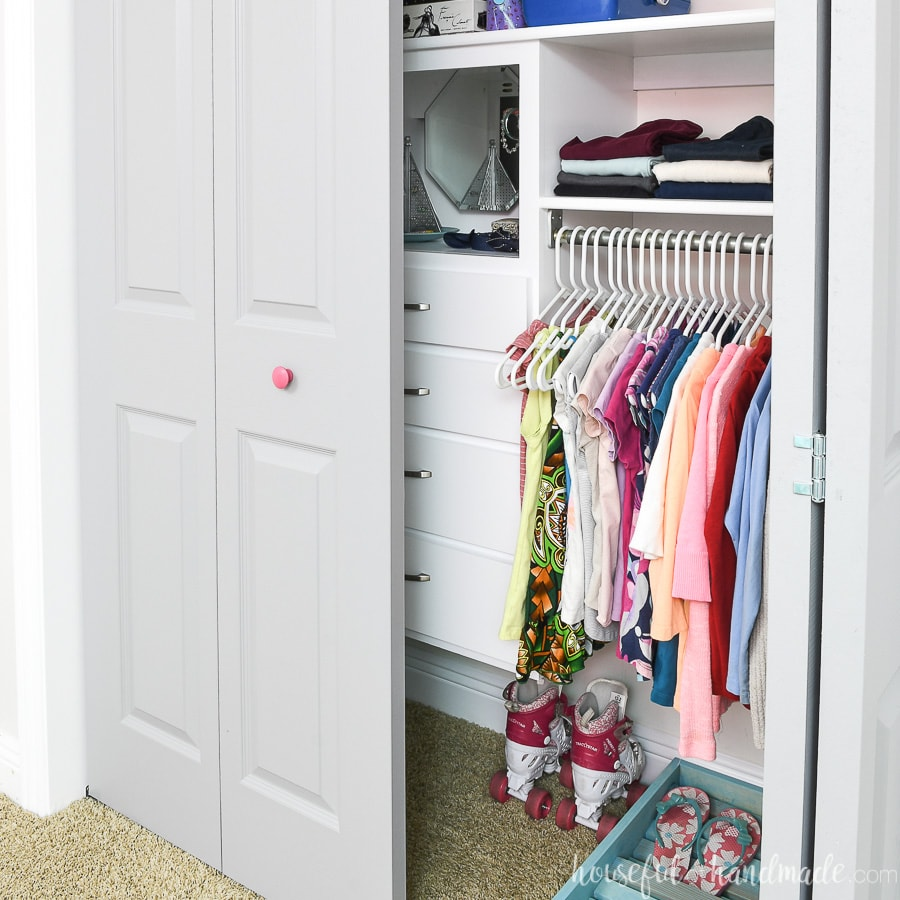 One door open showing the inside of the organized girls closet makeover done for only $100.