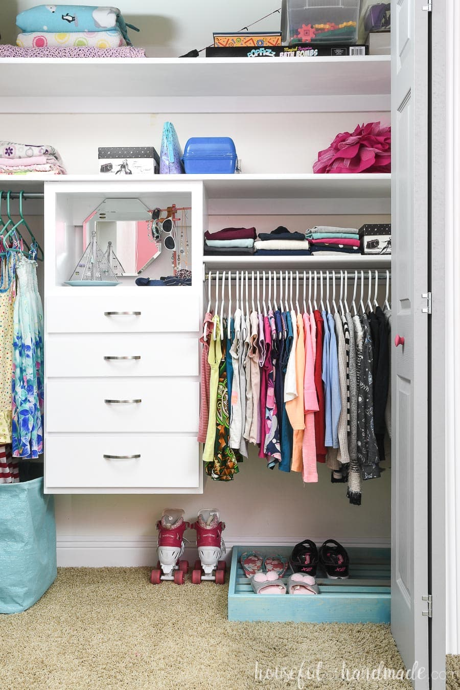 Full view of the organized girl's closet with shoe storage and closet organizer.
