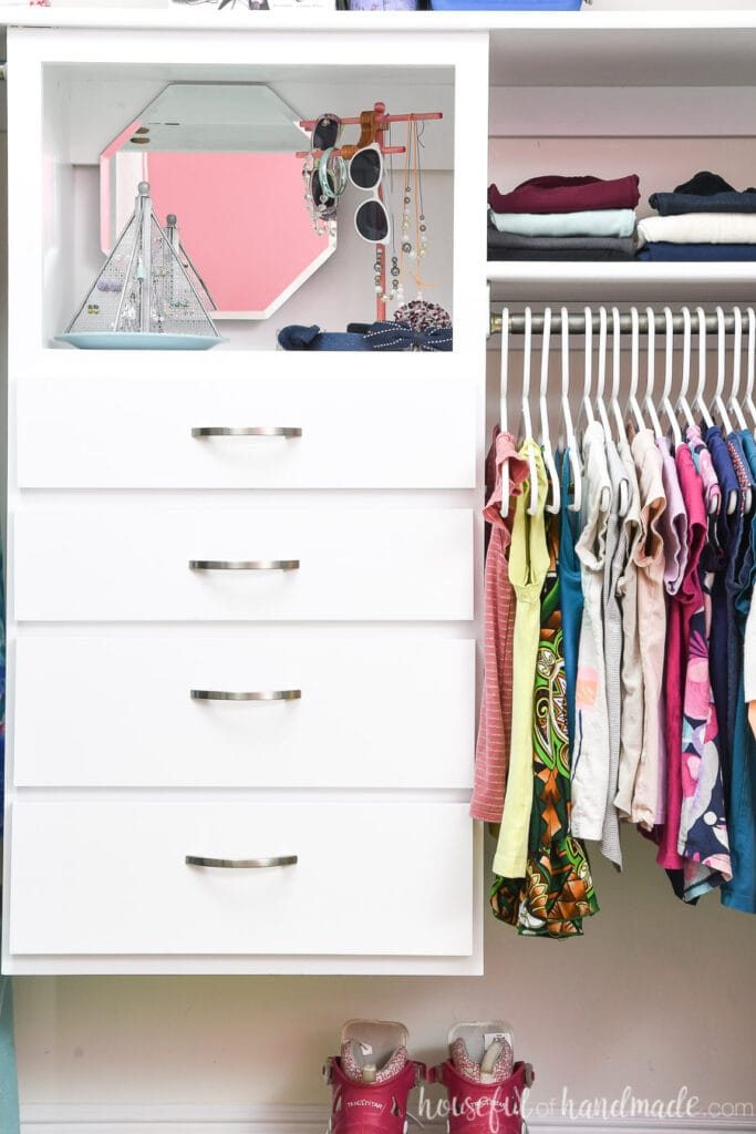 Close up of the DIY Closet Organizer built for the kids closet makeover.