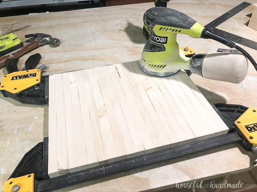 Sanding all the side slats at once with them clamped together.