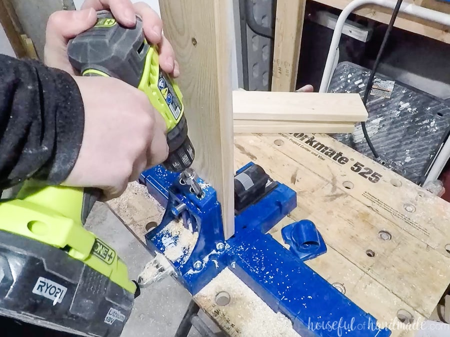 Drilling pocket holes in the 1x4 frame boards with the Kreg K5 master system.