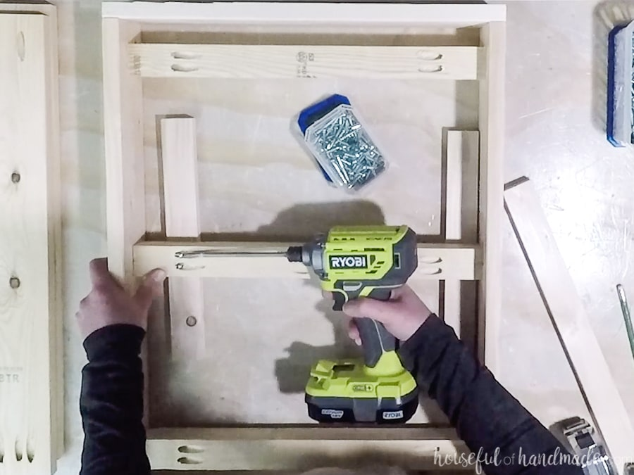 Adding 2x2 supports to the bottom frame.