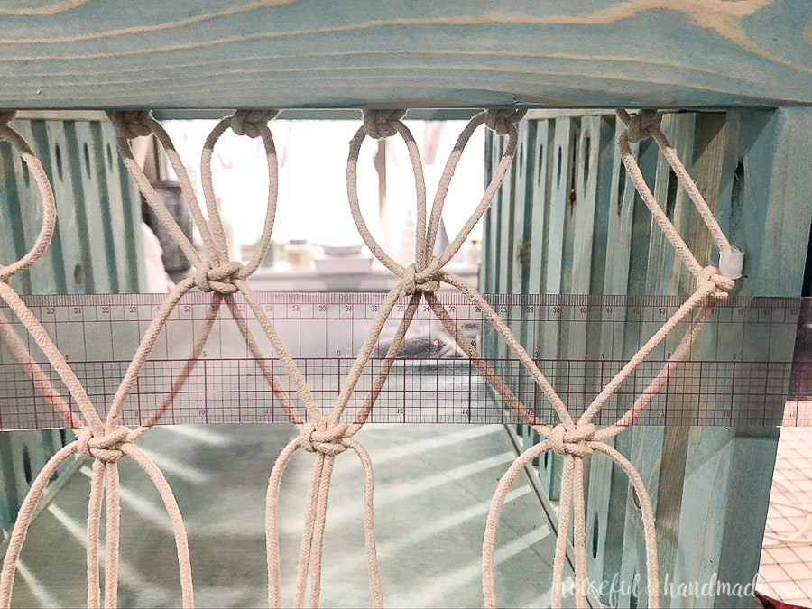"""The second row of macrame knots tied around the 2"""" spacer."""