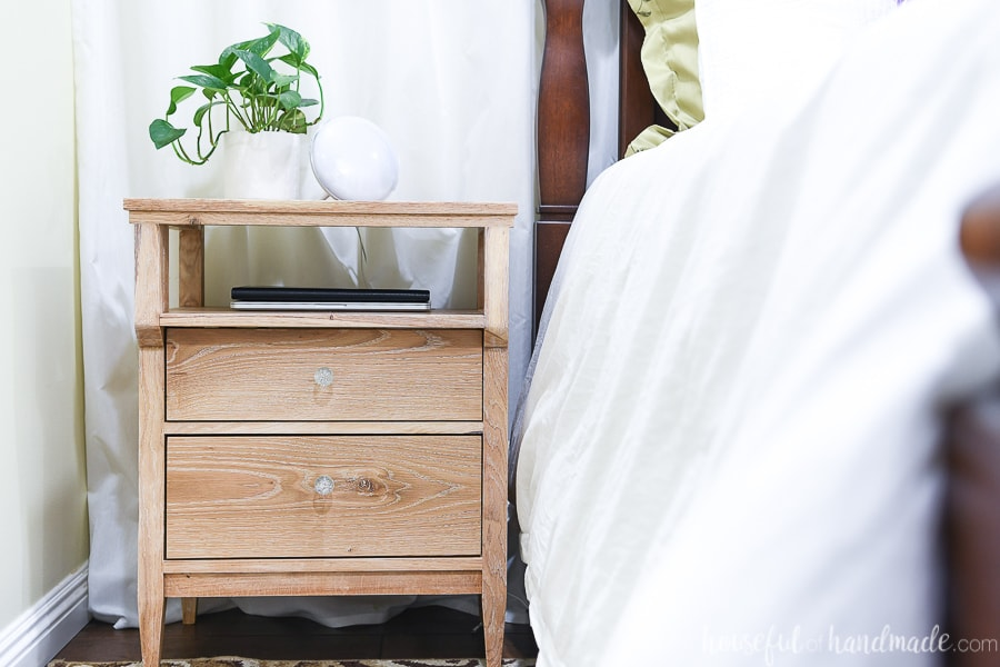 Tall nightstand with 2 drawers and open shelf for charging electronics or storing books.
