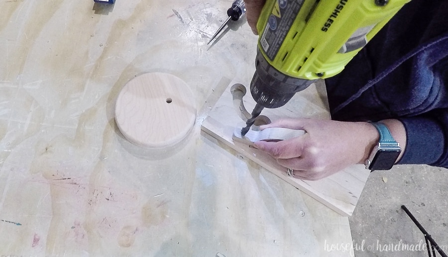 Drilling a hole on the underside of the top piece on the necklace holder.