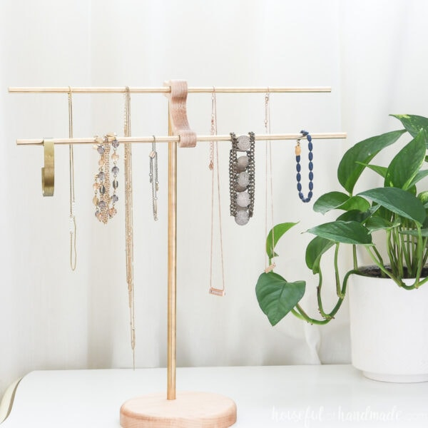 Gorgeous DIY necklace stand with brass rods.