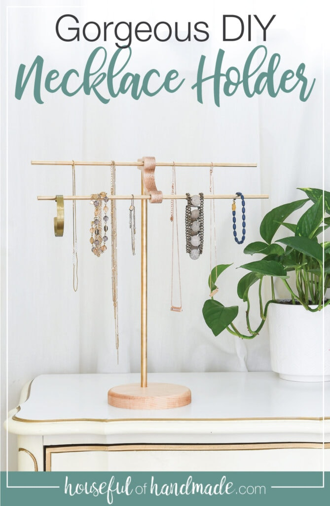 Brass and wood DIY necklace holder with necklaces and bracelets hanging on it.