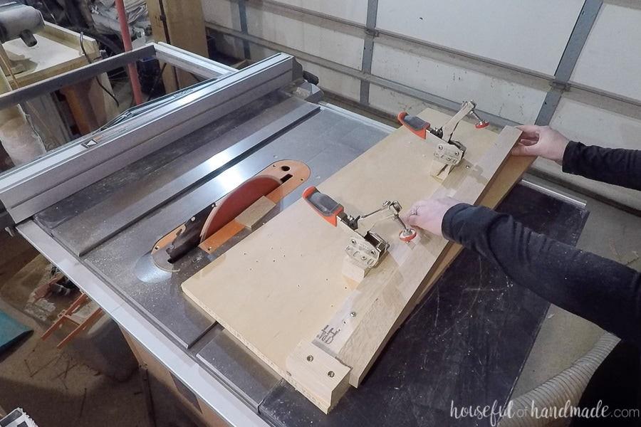 2x2 clamped into the jig sitting on the table saw.