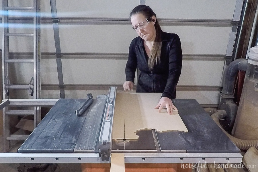 "Using a table saw to rip sheets of 1/4"" MDF into strips for the dividers."