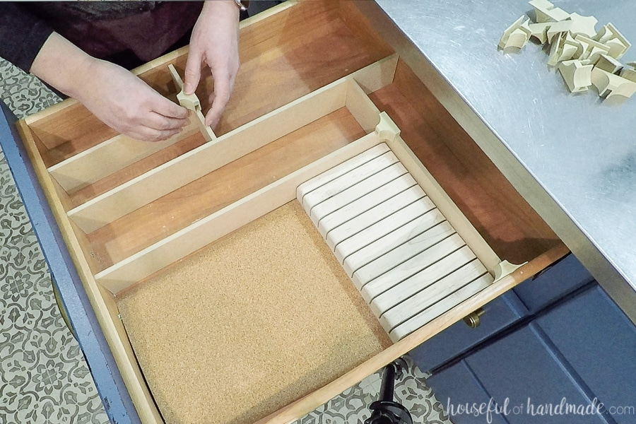 Laying the strips of MDF into the drawer and securing with the different wood clips.