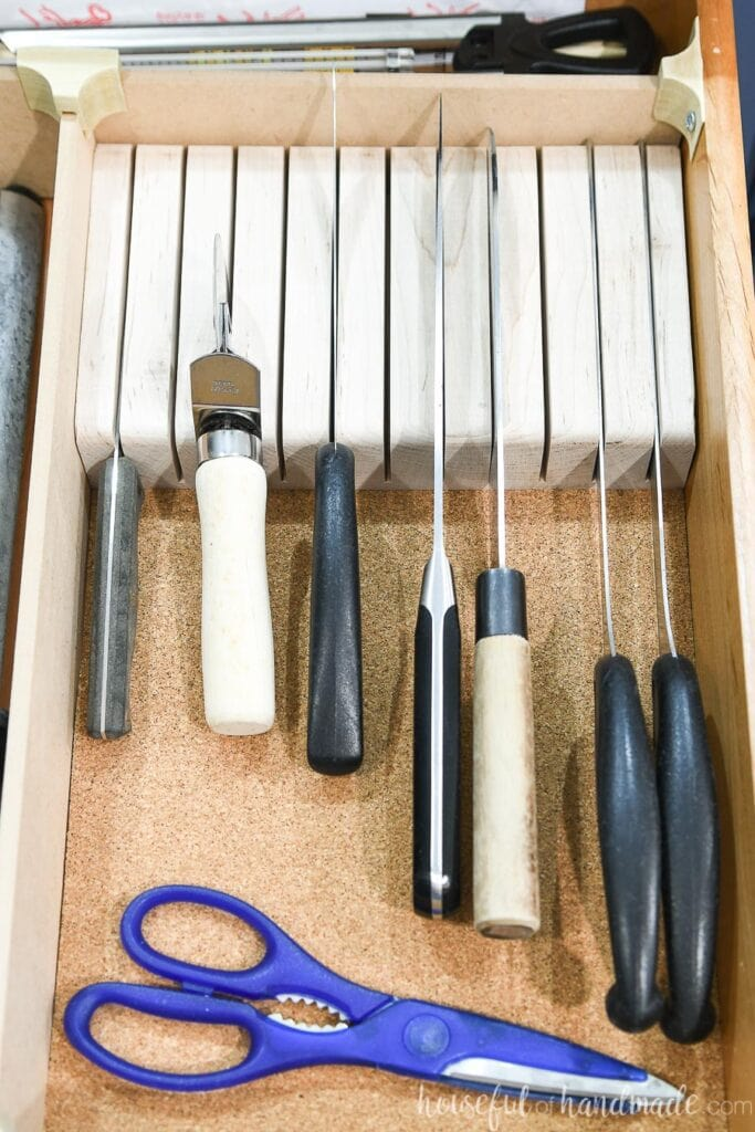 Close-up view of the finished knife block inside the organized drawer.
