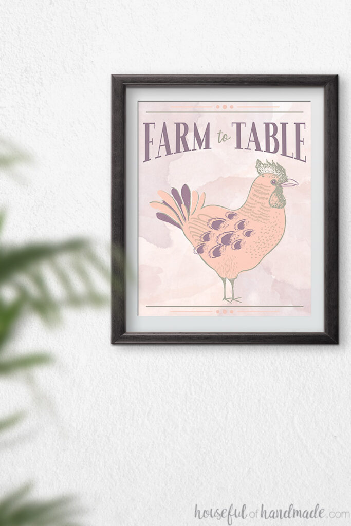 Black frame with rooster printable art in it.
