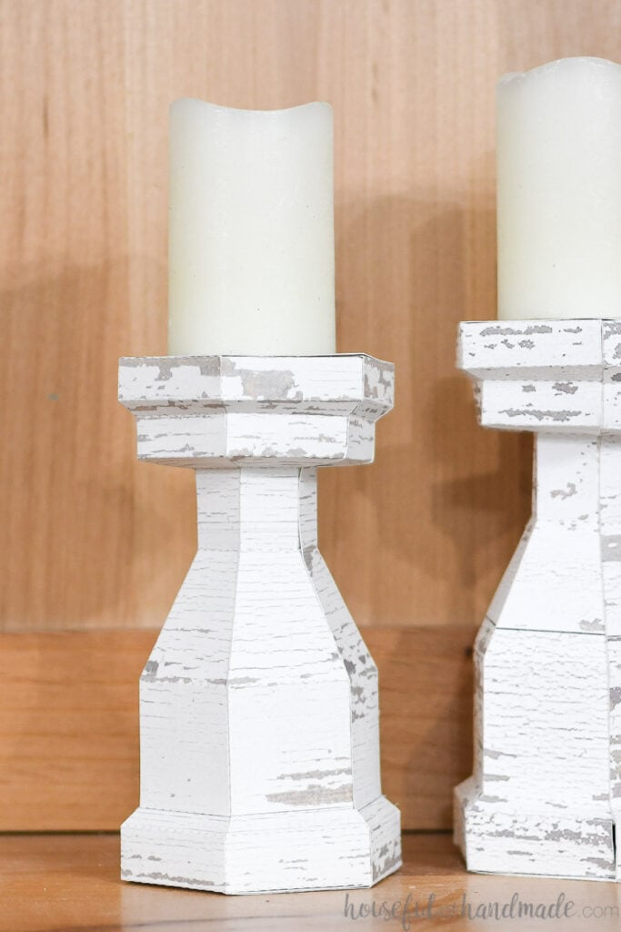 Close up of the faux wood farmhouse candlesticks made from paper.