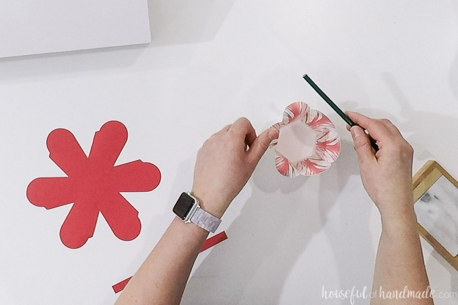 Curling the top of the flower petals over a pencil.
