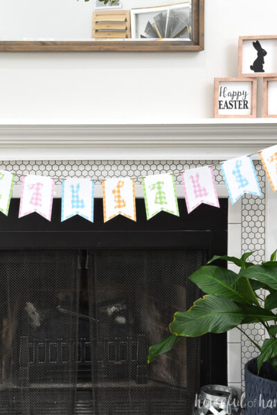 Fireplace decorated with a gingham check bunny banner hung on twine.