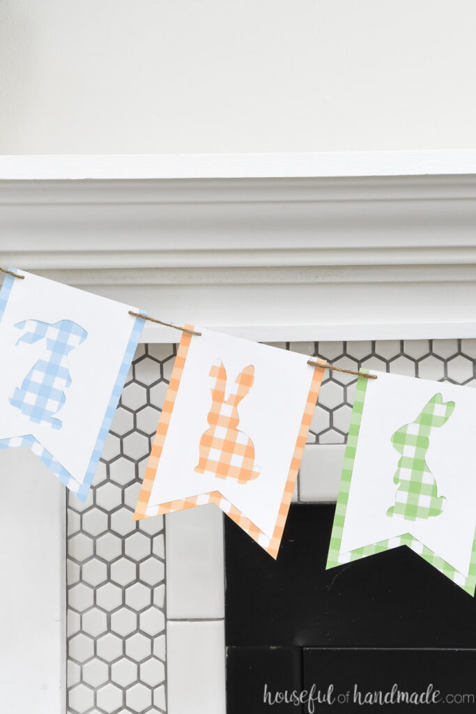 Close up of the three bunny cut-outs in the gingham check banner.