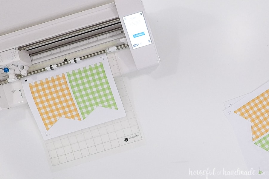 Cutting out the gingham check buntings with a Silhouette cameo print & cut.