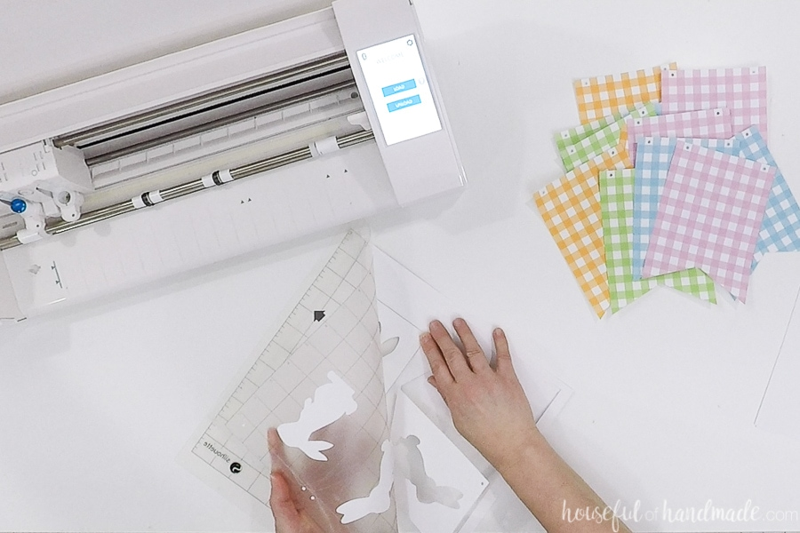Removing the white banner pieces from the cutting mat.