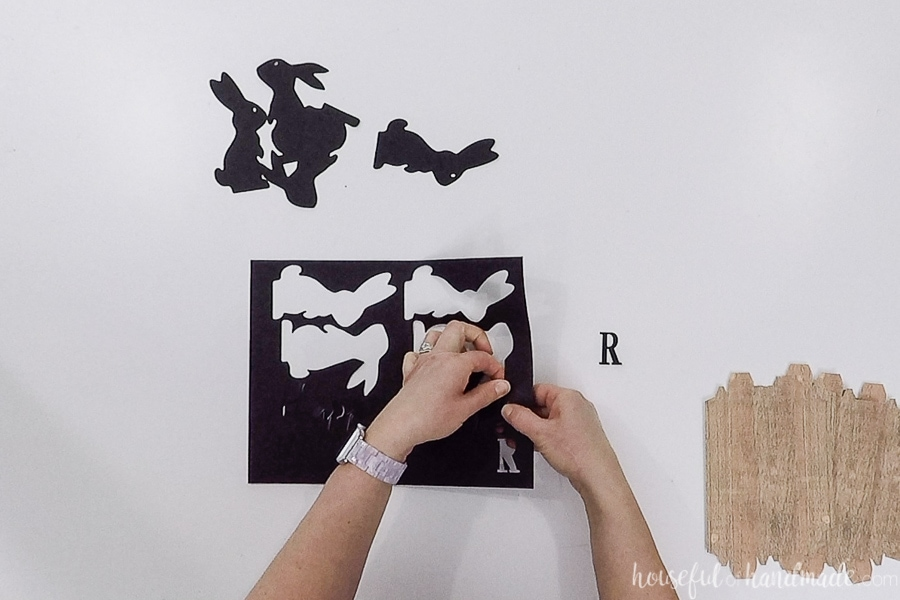 Removing the black pieces for the Easter signs from the paper after being cut with a Silhouette Cameo.