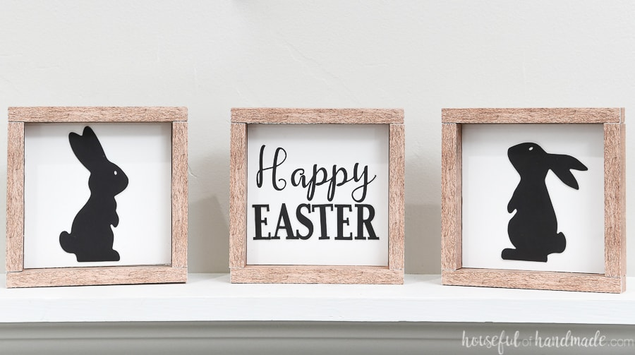 Three small Easter signs: one with an Easter saying and two with bunny silhouettes.