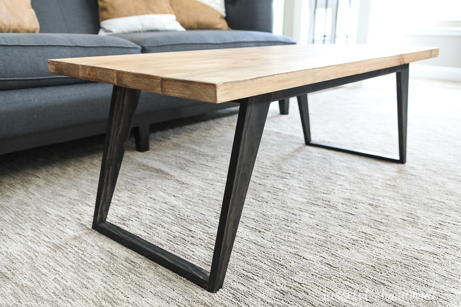Angled view of the modern coffee table with tapered legs.