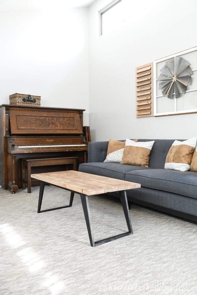 Living room with gray-blue sofa and DIY modern coffee table.