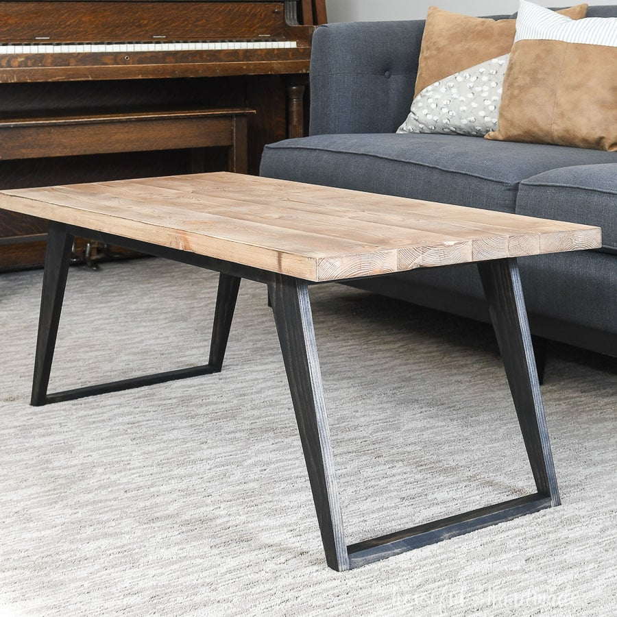 Close up view of the simple modern coffee table built from these free plans.