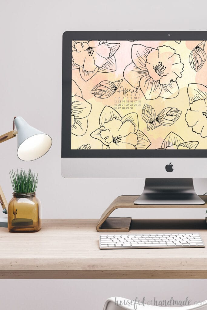 iMac computer with spring digital wallpaper of daffodil print on the background.