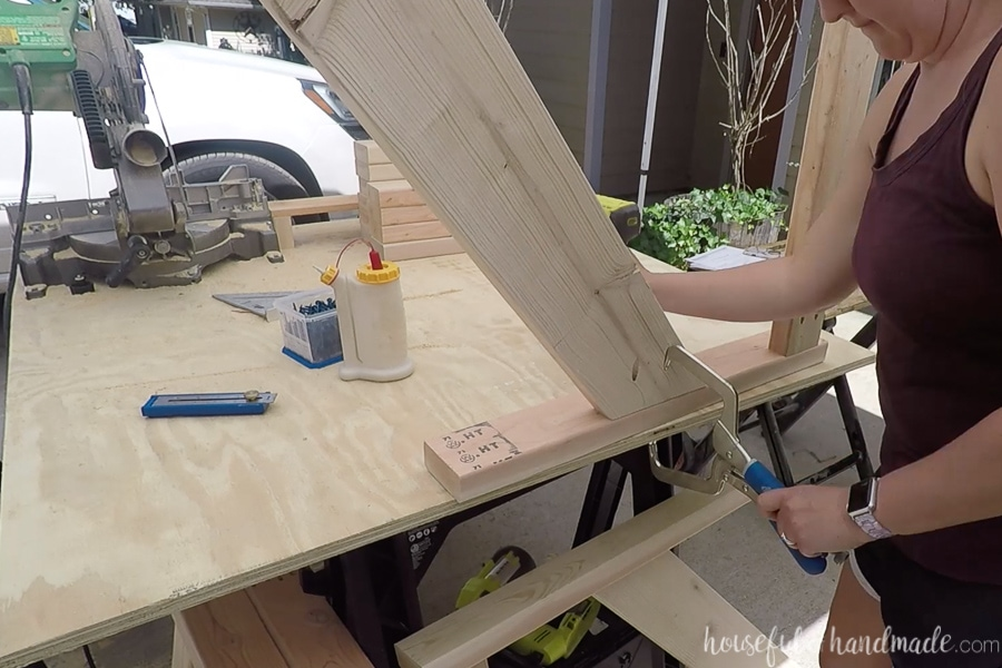Attaching the legs to the armrest of the chair for the side pieces.