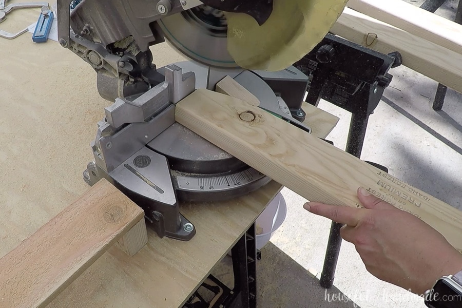 Cutting the angle off the back pieces for the outdoor chair seat back.