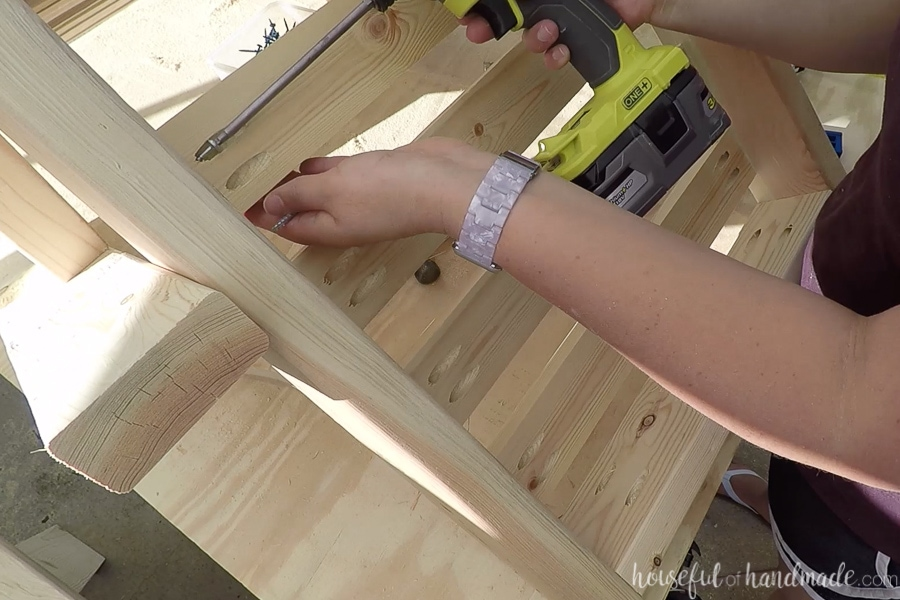 Attaching slats to the seat and chair back.