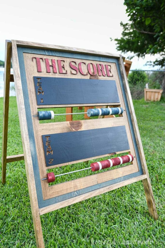 A-frame folding outdoor scoreboard with colored beads and chalkboard area for team names.