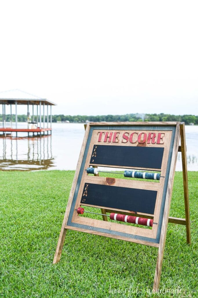 DIY scoreboard made from wood on the lawn.