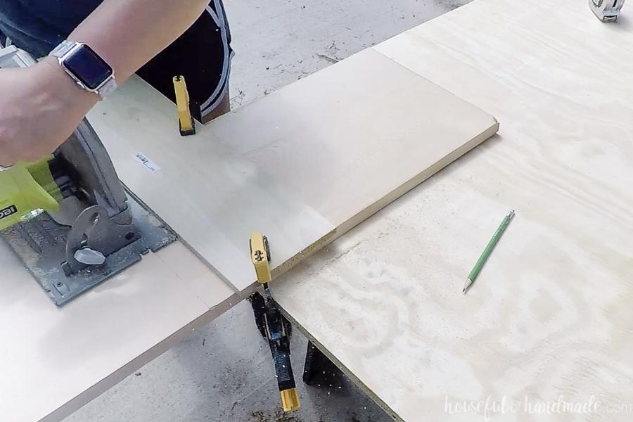 Cutting the 1x12 board with a circular saw.