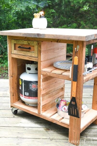 Rilling grill side cart with storage for accessories, spices, fuel tank and more.