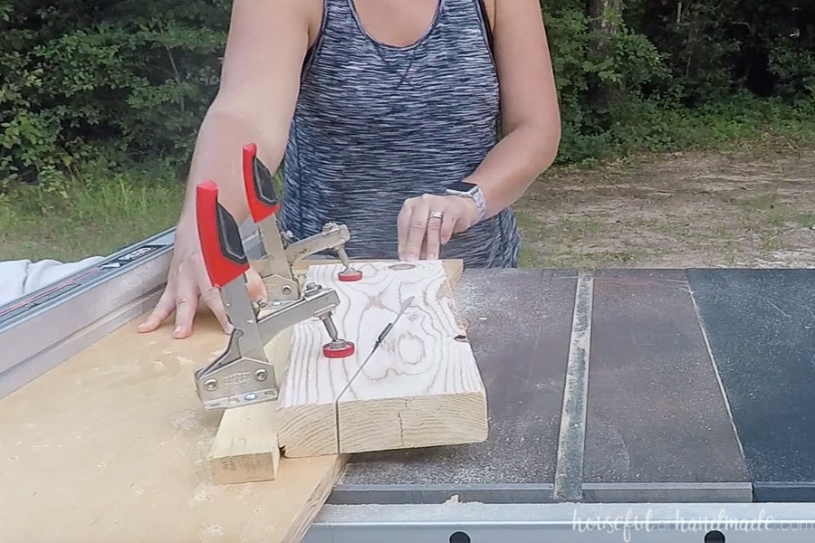 Cutting the angle on the back rests of the benches with a table saw jig.