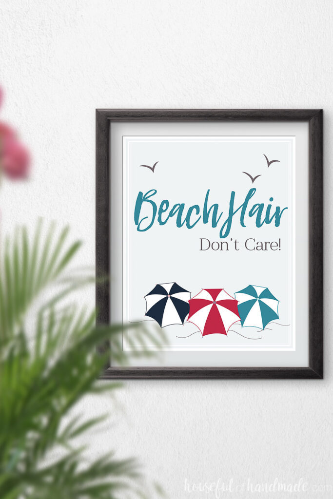Beach Hair don't care art with beach umbrellas in red, turquoise and navy.