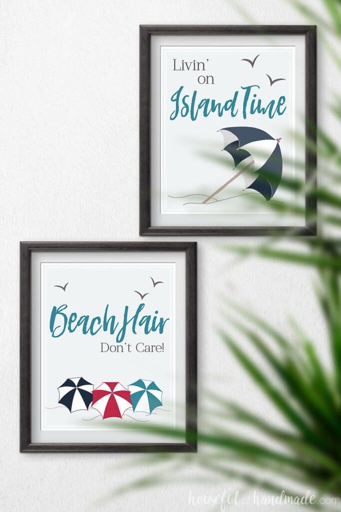 Two beach printables in black frames on the wall.