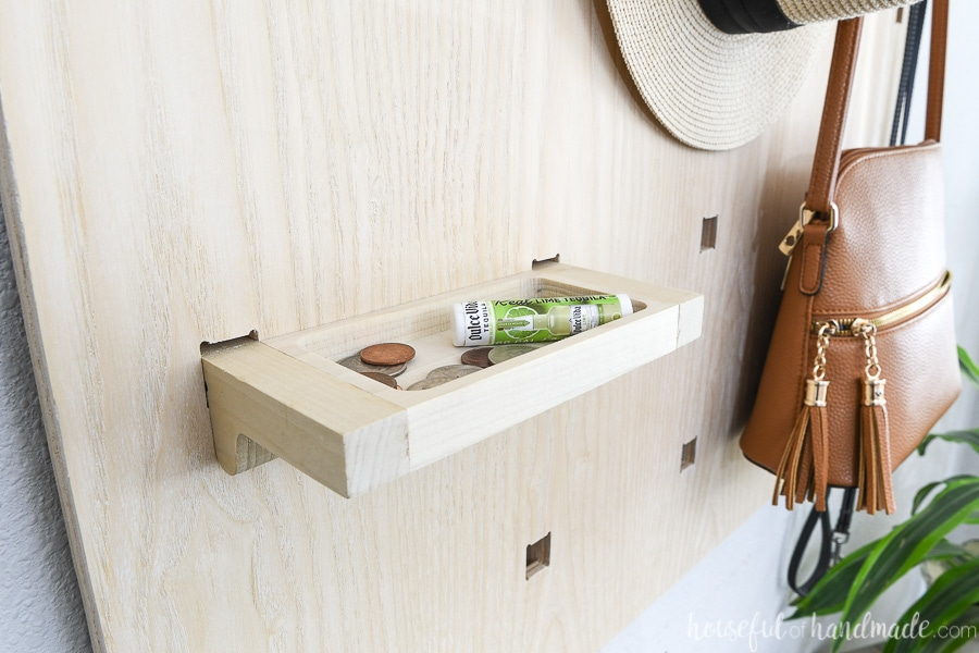 Close up view of the pocket tray for emptying your pockets in the entryway wall organizer.