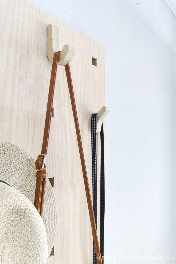 Close up picture of the two styles of hooks on the pegboard style entry organizer.