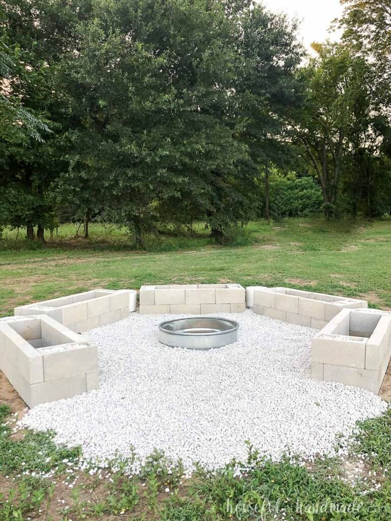 Fire cinder block bases in a hexagon shape with an opening where the 6th base would go with a fire pit in the center.